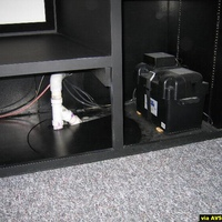 An unfortunate location for the sump pump so I had to use some of the cabinet space to hide it and the backup battery.