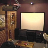 I converted our sunken un-used garage into this viewing room. It has a mitsubishi LCD projector mounted at 4 metres from a 100in 4:3 screen. I built this screen myself using curtain blockout & stretched it over security door aluminium, very...