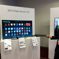 It almost goes without saying: TVs are getting smarter and more connected each year. A Samsung rep demonstrates features of the new 2014 sets