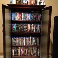 Rosewood Blu-ray/HD DVD/DVD Cabinet (holds *some* of my collection; another cabinet holds the rest along with about 300 CDs)
