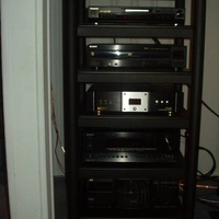 Rack from StudioTech, JVC 200 cd player, Onkyo SR800 7.1 Receiver, Monster 3600, Sony 5cd Carousel, Panny RP56, from bottom to top