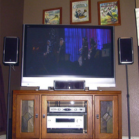 "Bought a new Panasonic 50"" plasma, Toshiba HD-DVD and Yamaha 5.1 surround today. Put it all on and in a solid oak cabinet I thought looked nice. The speaker stands are temporary until I find sturdier ones I like."