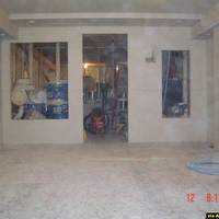 This is a pic of the back of the room where shelving, door, and equipment rack is located.