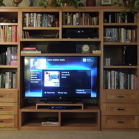 All done, finally. My new LG 55 LM 7600, new additional cabinetry, new bluray, main and center channel speakers. Yea.