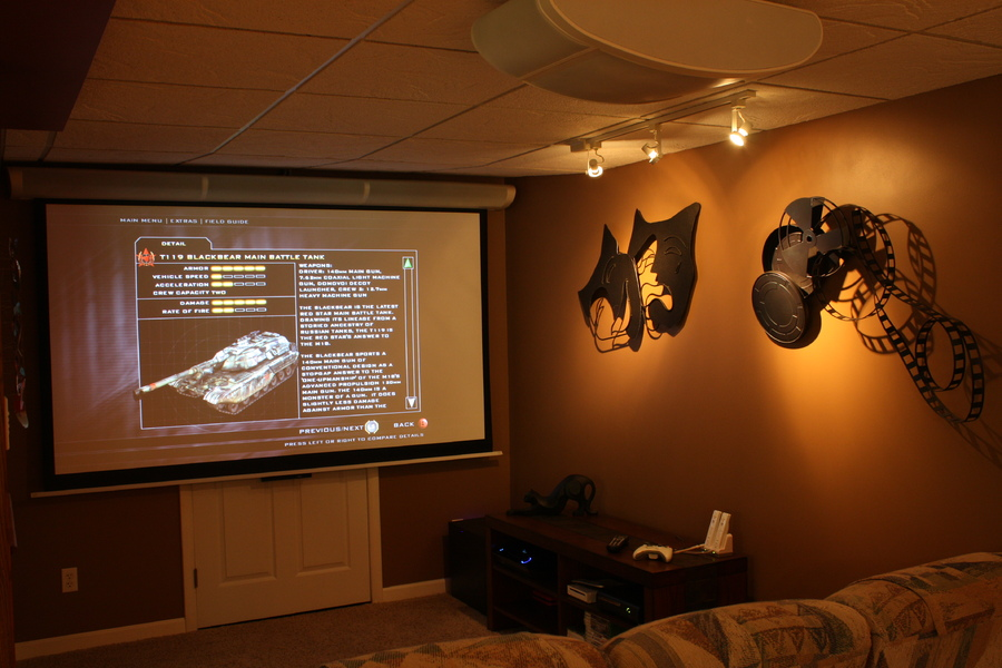 Gaming area with Epson Ensemble system.  Hi-Def and 5.1 all in one kit complete with drop down screen.  Speakers are in the drop down screen assembly and the rear speakers are in the projector mount.