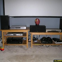 An old coffee table and TV stand being used to house our AV equipment and Xbox.