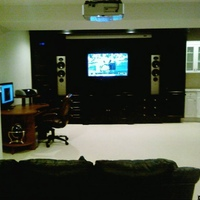 This is my theater/or Entertainment area, sadly my wife did not a dedicated theater, so what I got was a mix. It has the theater and screen but also a bar fridge, sink, fireplace, off to the side. The only thing I added was the htpc area, I have...