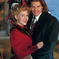 "cc: (L-R): Darla (Julie Benz) and Angel (David Boreanaz) in the 1800s.  From the episode: ""Darla""