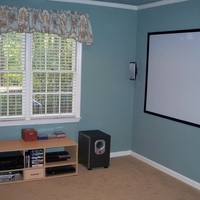 This is the newly finished 2.37:1 1080P theater I recently completed.  The room is an 11x11 sitting room off the master bedroom. The sound setup is an Onkyo 605 with JBL speakers.  The PS3 and HD-A2 provide the sources.