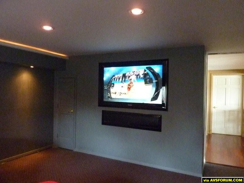 This used to be a garage then it was a bedroom until I decided to make it my HT room. It's partially underground so the acoustics are great. Just finishing up some detail work so thought I post a pic.