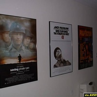 $9 Repoduction Movie Posters off EbaY.  Metal Frames ~$25 ea from Frames USA.