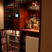 Showing door open on DVD storage, cabinet is custom built and holds 370 DVDs