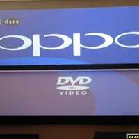 Oppo splash screen shown in ambient light, as well as in a darkened room.  Two screens with no projected image.