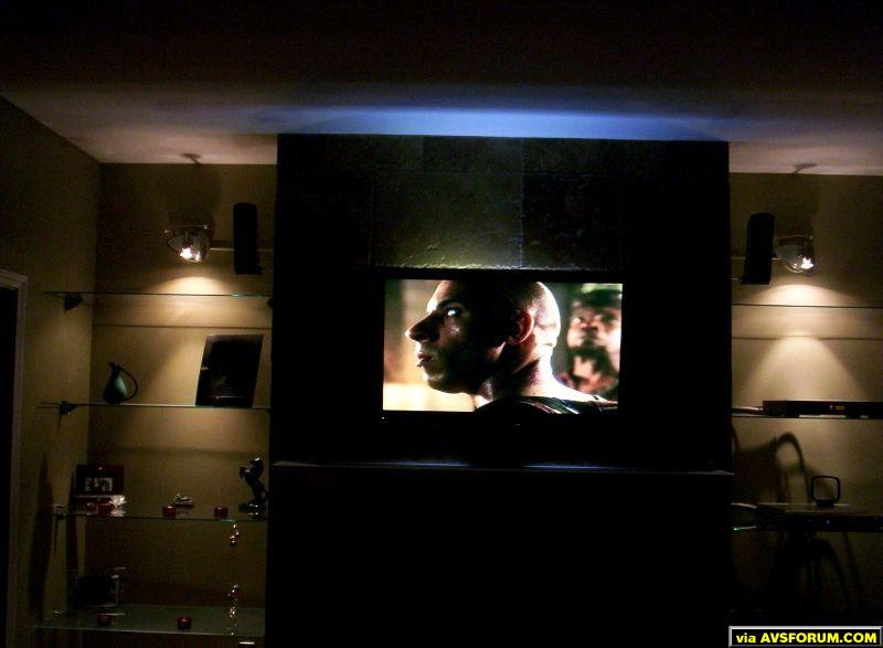 My wife and I completed the living room the first week in May 2005. The digital camera used is not the best. The backlight is a lot brighter than the photo shows.
