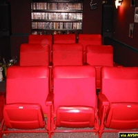 This View shows my 3 rows of Seats. The Front Row is Bolted to the Floor. The 2 rows in back are placed on a carpeted Riser we built. The Riser is Framed with Rope Lighting and contains Aura Bass Shakers inside of it. The Seats were taken from a...