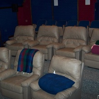 Here's the seating in the theater. There are seven Berkline recliners with Aura bass shakers mounted under each seat and eight theater seats in the back row. Some of the older guests prefer the back row over the front two. The seats are on...