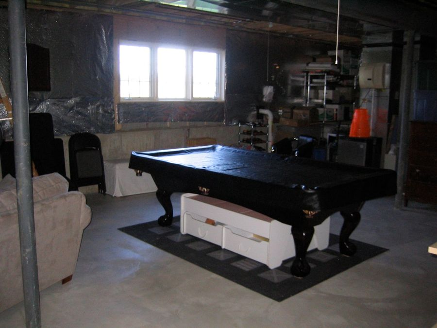 Unfinished pool table and bar area