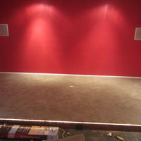 Carpeted riser with recessed outlets on top and front for power seating.