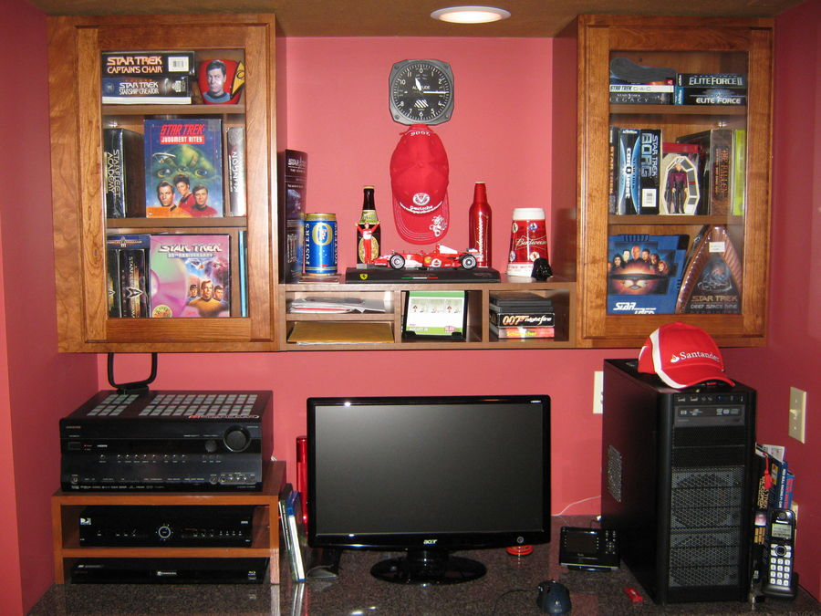 Work station.  Onkyo TX-SR605 7.1 receiver, DirectTV HD DVR, Sony BDP-S470 Blu-Ray player, Star Trek PC game collection, small Ferrari F-1 shrine :)