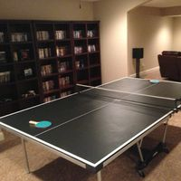 Table tennis next to my game and movie collections