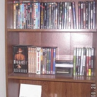 My small collection of DVDs on top shelf and to the left of 2nd shelf down.
