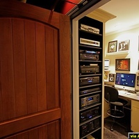 This is what I call my Media Room.  It is adjacent to the dedicated theater.  I wanted a room dedicated to the media and clutter so the theater would stay clean.  All media formats are stored here as well as my two Mac's containing 27,000...