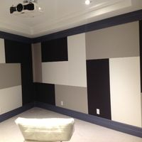 Rear of home theater prior to placement of game machines.  Ceiling mounted Epson 5010.  Acoustic panels installed in walls.