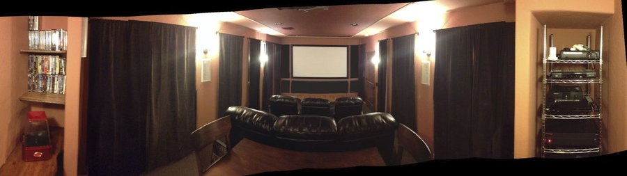 panoramic shot [from left to right] dvd/popcorn rack, front of room and equipment rack in niche.