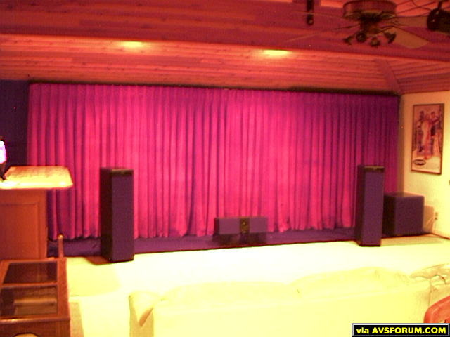 "motorized drapes, Meridian 5500 front and rear surrounds, Meridian 5000 center and side surrounds, Velodyne 18"" sub"