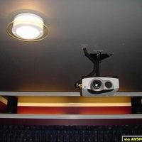 Picture of Sony 10HT projector in our primary home theater.  Ceiling mount is a Sony, cables are wrapped in a stretchy fabric cover to the ceiling faceplate.  