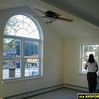 Ceiling fan and window in the vaulted section of the rear.