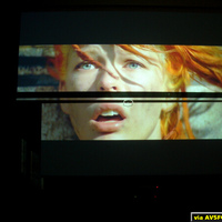 "This is a photo of a 100"" Highpower on top of my old BOC screen directly behind. Projector is ceiling mounted, and this photo is taken from the seating position on a couch. While it is obvious the gain has dropped off, notice the area on the..."
