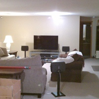 Not too long after we moved into the house.  Here's the basement as you can see it's pretty big, (for us), and open.  I calculated it without the bedroom or bathroom at 5,250 sq. ft.