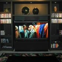A PANORAMIC VIEW OF THE NEW CASTLE CINEMA -- A former living room turned into a dedicated HT.