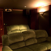 My home theater project, completed in 2003.  Not much has changed other than I finally have a door on the breaker panel in the lobby.  Some of the electronics have changed (peripherals only, not the heart of the system) and will post pics when I...