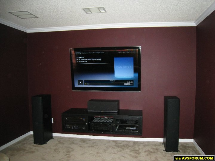 Formal sitting room turned Media Room. Wall mounted TV, wall mounted entertainment center, all wires neatly hidden.