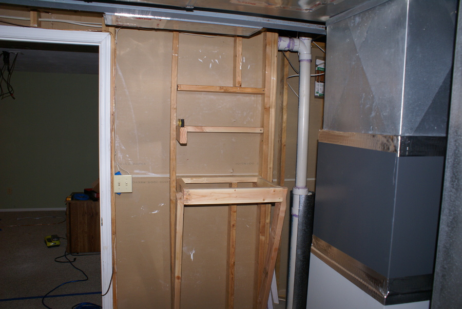 I know the equipment rack isn't pretty, but it's in the unfinished part of the basement so it won't be seen by anyone. Most of it will be covered by plywood and the drywall will be cut to the exact dimensions of my equipment to create a custom look from the front.