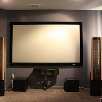 This is my cozy little home theater. Only 12x14. Seats four on some Fortress chairs. Nice Stewart Films Screen. Front channels are all Martin Logan. 4 surrounds and 2 subs are Triad. Integra 8.8 as the receiver. Using xbox 360 for HD-DVD and PS3...