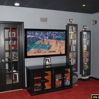 "I originally created this theater using an LCD projection TV but have since upgraded to a 60"" Pioneer Elite.  I just got the custom cabinet that I ordered from a local store so here is my theater in it's 'currently complete' state.  Luckily..."