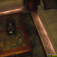 Rope lighting placed under recliner and couch.  All remote controlled.