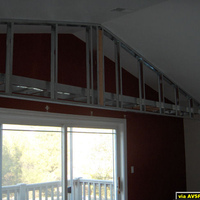 My new home theater in the rough framing stage - Jan. 2007. This shows the electric screen soffit framing.