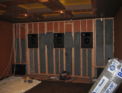 Baffle wall with sealed SEOS Zephyr speakers.  Framing done, insulation going up.