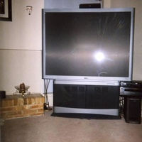 Phillips 55 inch widescreen HD T.V. Sony dvd player and a Sony Surround System