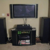 These are pictures of my living room theater.  Soon to be replaced are the dvd player and display.