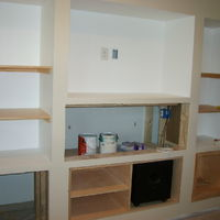 Shelving and some of the cabinetry is in place. Sub-woofage is in place.