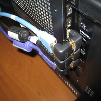 Monoprice #3850 Right Angle HDMI Adapters - two of em snapped together to re-direct the cable flat against the back of the TV